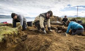 Archaeologists dig at the site of the first ship burial, where the human and dog bones, the ship and sword were found. You can see how close the waters of the fjord are in the background.
