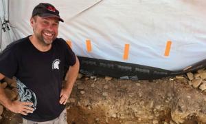 Metal-detectorist Mariusz Stepien standing where the Bronze age treasure hoard was found in Peebles near Edinburgh.          Source: Southern Reporter