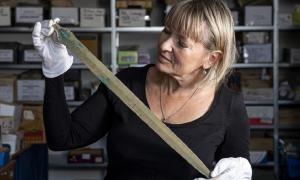 Martina Bekova of the Rychnov Museum with the Bronze age sword.             Source: David Tanecek, CTK