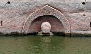 600-Year-Old Buddha Statue Temporarily Emerges from the Waters, Reminding Locals of a Forgotten Past