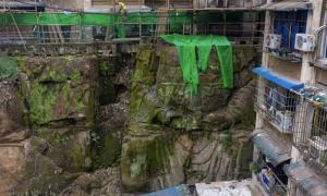 Surprise Discovery of a Headless Buddha Statue Beneath Chinese Apartments