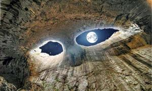 """The Eyes"" in the Prohodna Cave near Karlukovo, Bulgaria."