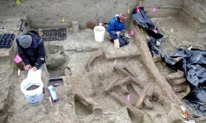 Archaeologists working in the 1,000-year-old house at the Rising Whale site at Cape Espenberg, Alaska.