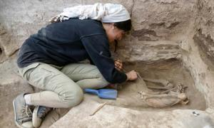A researcher excavating an adult skeleton at the Neolithic site of Catalhoyuk in Turkey.          Source: Scott Haddow / Ohio State University