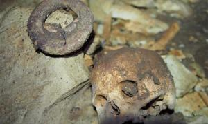 An iron currency ring and human skull found in the rare cave burial in Gabon, Africa. Source: NOT Engineers