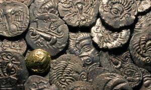 Roman and Celtic coins found at the excavation site in Jersey.            Source: Jersey Heritage