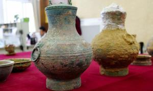 A pair of bronze pots, one containing the first real example of an ancient Chinese elixir of life, were unearthed from a Western Han Dynasty tomb in Luoyang, Henan Province.