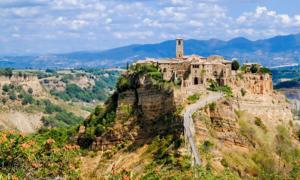 Civita di Bagnoregio an ancient, dying city atop a crumbling rock. Source: JethroT / Adobe Stock.