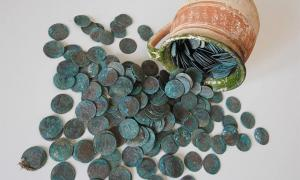 Coin hoard from early 18th century stashed in ceramic mug. Source: KPÚ Košice