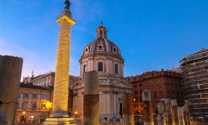 Trajan's Column and The Church of the Most Holy Name of Mary at the Trajan Forum, Rome, Italy.