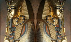 Sarcophagus of Tutankhamun with close up on the crook and flail. Source: Public Domain