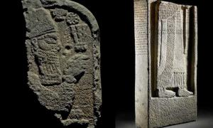 The broken top and bottom sections of the Assyrian stele.