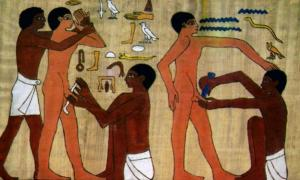Ancient Egyptian men undergoing circumcision.