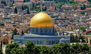 The Dome of the Rock glistens in Jerusalem's cityscape.