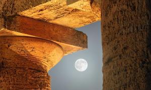 The moon among the columns of the Doric Temple at Segesta, Sicily. Source: ildiora / Adobe Stock