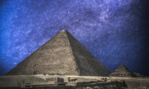 Egypt's Pyramids of Giza, in the night sky. 	Source: 	Aliaksei / Adobe stock