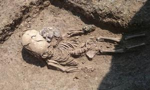 The remains of the toddler with an elongated skull in Crimea. Credit: Archaeology Fund