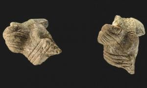 Fragments of a female figurine from Hohle Fels in south-western Germany dating to the Aurignacian period roughly 40,000 years ago. Images: J. Lipták/University of Tübingen.
