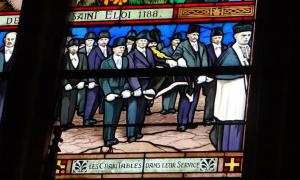 Stained glass window showing the French brotherhood 'Confrérie des Charitables de Saint-Éloi',  in Saint-Vaast Church, Béthune         Source: CC BY-SA 3.0