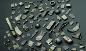 The Gaulcross silver hoard, including a silver ingot, Hacksilber and folded bracelets.