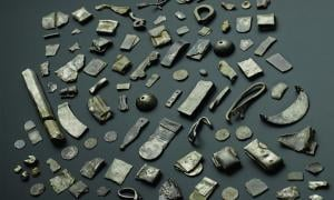 The Gaulcross silver hoard, including a silver ingot, Hacksilber and folded bracelets.