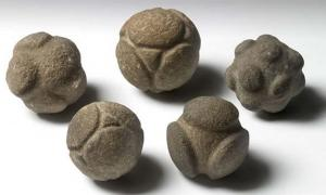 Five carved stone spheres from Scotland held at the Ashmolean Museum