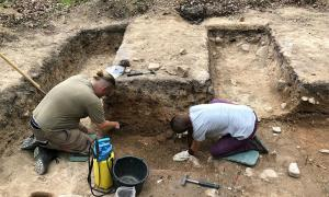 Archaeologists investigating the German burial site.  Source: Antiquity Publications Ltd