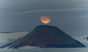 1110 AD was the year volcanic eruptions caused the disappearance of the Moon and sparked global famine. Pictured: representation of the Moon over a volcano. Source: Daniel / Adobe stock