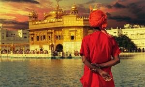 Pilgrim at the golden temple in the city of Amritsar-India, main temple of Sikhs, during sunset.            Source: MICHEL / Adobe Stock
