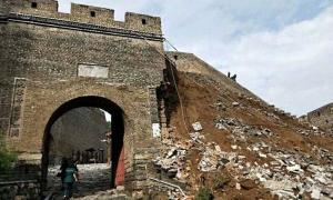 The damaged section of the Great Wall of China.