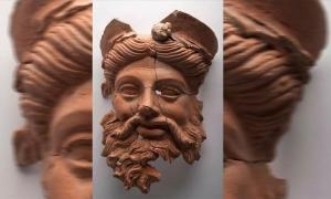 The Greek god mask of Dionysus recently unearthed in an ancient Lydian kitchen in western Turkey.               Source: Anadolu Agency