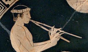 Youth playing the aulos, detail of a banquet scene. Tondo of an Attic red-figure cup, ca. 460 BC–450 BC.