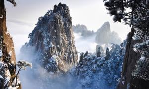 Taking Beauty to New Heights in China: What Stunning Sights Emerge on Huangshan and its Bridge of Immortals?