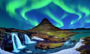 Northern Lights, Aurora borealis at Kirkjufell in Iceland. Representative of Icelandic Viking Settlement.           Source: tawatchai1990