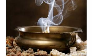A copper bowl burning frankincense.