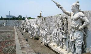 The northeastern corner of an Indonesian national monument. In this section the Majapahit Empire is depicted including Gajah Mada at the nearest right. Jakarta, Indonesia.