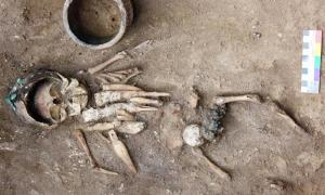 Infant discovered in 4,500-year-old burial mound with eight intricately carved figurines. The infant also wears headgear made from 11 copper plaques sewn together.