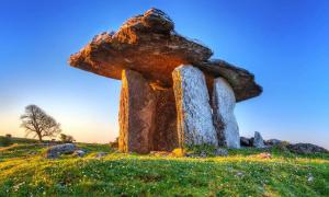 Poulnabrone portal tomb in Burren at sunrise, Ireland.