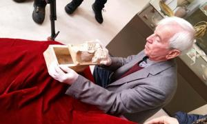 Professor Kasimir Popkonstantinov and the marble reliquary that potentially held John the Baptist's bones.
