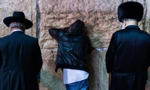 Three different Jewish people giving Selichot prayers at the Wailing Wall, Jerusalem