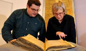 Gary Brannan and Sarah Rees Jones examine the note regarding Joan of Leeds in one of the archbishops' registers.