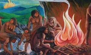 Representation of prehistoric people around a campfire.