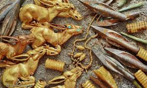 Some of the 3000 gold and metal objects found in the burial mound in Kazakhstan
