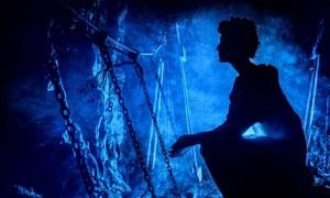 Silhouette of a mysterious witch inside a cave