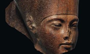 The brown quartzite King Tut statue for auction. Source: Christie's.