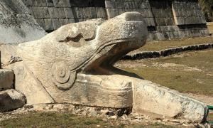 Kukulkan as a snake deity at the base of the west face of the northern stairway of El Castillo, Chichen Itza