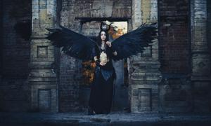 Lilith as a demon with black wings.