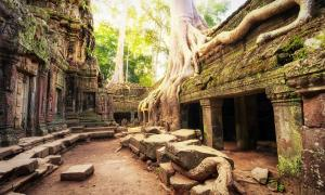 Khmer Empire city found north of Angkor Wat. Here, Ta Prom Khmer ancient Buddhist temple in jungle forest