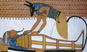 Anubis Reconstructing Osiris (1350 BC, Tomb of Ramses 1, Egypt).