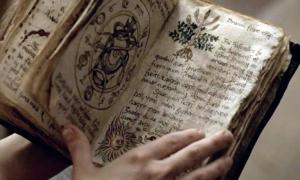Person holding an ancient grimoire filled with spells, curses, and incantations
